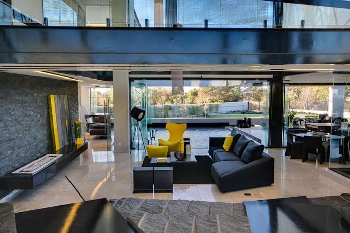 Architecture : Villa de vitres, pierres et métaux 9