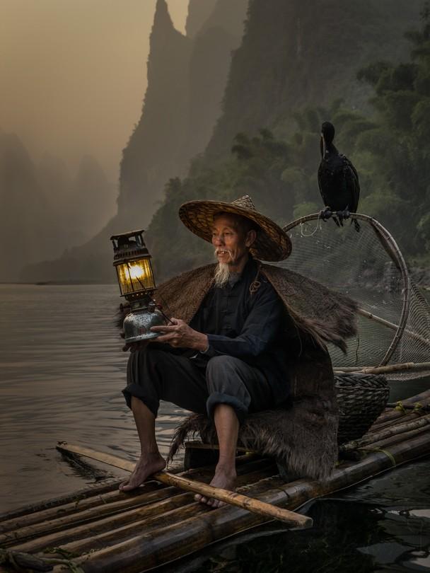 Cormorant Fisherman  by Carlos Monteiro