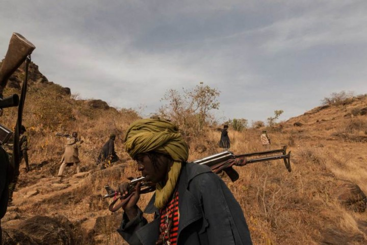 Members of the rebel group the Sudan Liberation Army led by Abdul Wahid (SLA-AW) climb towards the front lines in Jebel Marra, Central Darfur, Sudan, March 4, 2015. The mountainous area has been a stronghold of the SLA-AW since the conflict between the neglected population and the Sudanese government broke out in 2003.