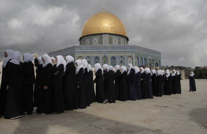 Palestinian school girls walk in line past the Dome of the Rock at the Al-Aqsa mosque compound in Jerusalem's Old City on October 27, 2015. Israeli Prime Minister Benjamin Netanyahu scrambled to contain inflammatory rhetoric from his government over the holy site, which is sacred to both Muslims and Jews, at the heart of a wave of deadly Palestinian unrest. AFP PHOTO/AHMAD GHARABLIAHMAD GHARABLI/AFP/Getty Images