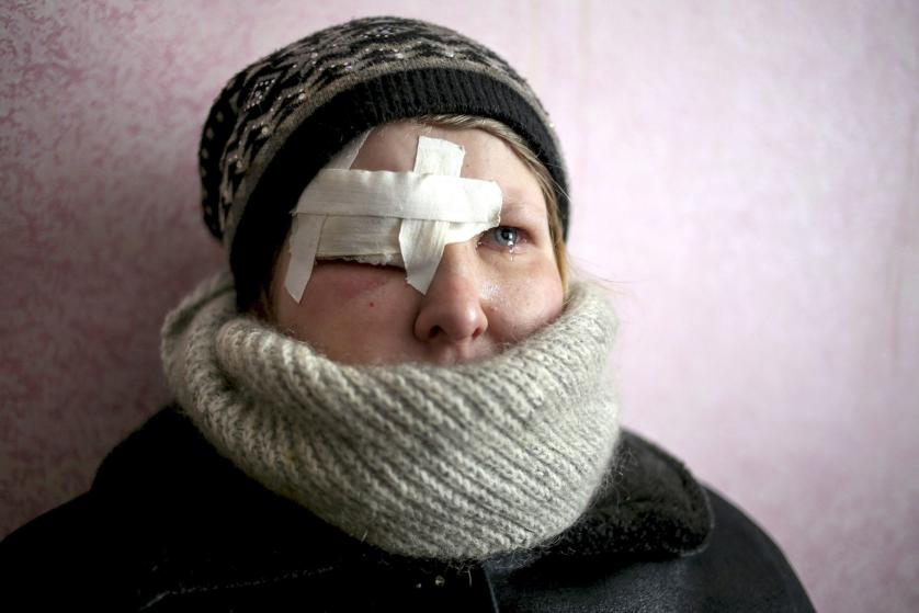 epaselect epa04623992 Yulia Novomlynets (18) waits in a line to receive the humanitarian aid in the local Palace of Culture which is used as a bomb shelter in Mironovka village, near Debaltseve of Donetsk area, Ukraine, 17 February 2015. Fighting escalates in eastern Ukraine, only hours after German Chancellor Merkel discusses the implementation of a three-day old ceasefire with Ukrainian President Poroshenko and Russian President Putin, who heads to Budapest. EPA/ANASTASIA VLASOVA
