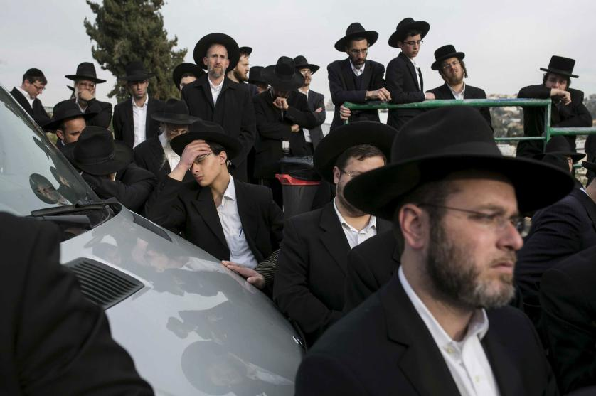 Mourners gather during the funeral service for seven children from the Sassoon family before their burial in Jerusalem March 23, 2015. The seven children from the Orthodox Jewish family died early on Saturday when flames ripped through their Brooklyn home in one of New York City's deadliest fires in years, officials said. Police have identified the children who died as Yaakob Sassoon, 5, Sara, 6, Moshe, 8, Yeshua, 10, Rivkah, 11, David, 12, and Eliane, 16. REUTERS/Baz Ratner