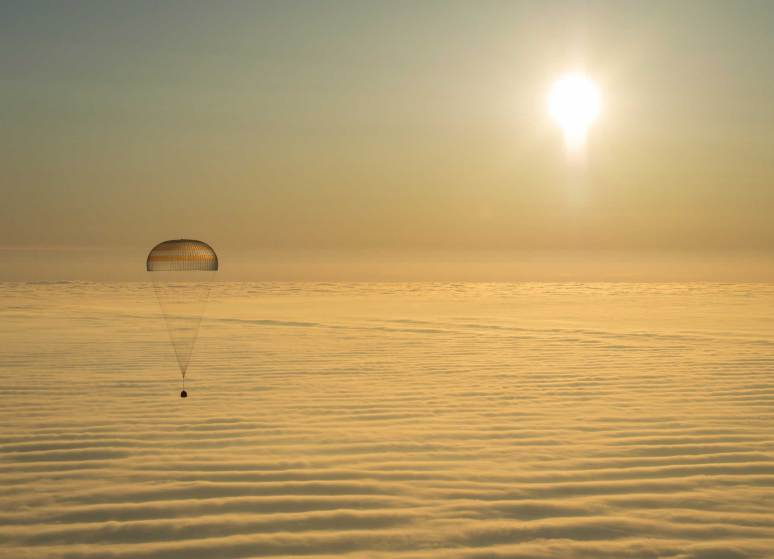 "TOPSHOTS The Soyuz TMA-14M spacecraft is seen as it lands with Expedition 42 commander Barry Wilmore of NASA, Alexander Samokutyaev of the Russian Federal Space Agency (Roscosmos) and Elena Serova of Roscosmos near the town of Zhezkazgan, Kazakhstan on Thursday, March 12, 2015. NASA Astronaut Wilmore, Russian Cosmonauts Samokutyaev and Serova are returning after almost six months onboard the International Space Station where they served as members of the Expedition 41 and 42 crews. AFP PHOTO / NASA / BILL INGALLS==RESTRICTED TO EDITORIAL USE / MANDATORY CREDIT: ""AFP PHOTO / NASA / BILL INGALLS""/ NO A LA CARTE SALES / NO MARKETING / NO ADVERTISING CAMPAIGNS / DISTRIBUTED AS A SERVICE TO CLIENTS==BILL INGALLS/AFP/Getty Images"