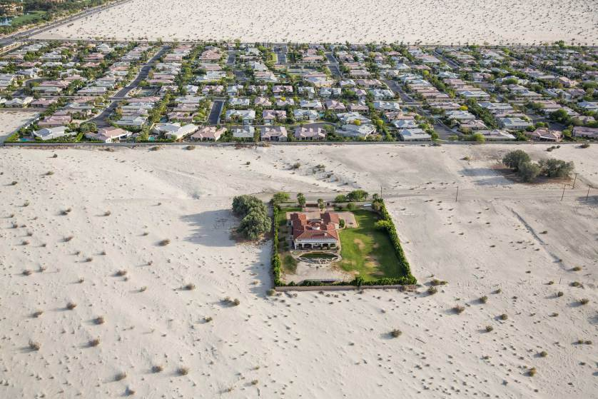 Properties surrounded by desert in Rancho Mirage, Calif., April 3, 2015. The state?s history as a frontier of prosperity and glamour faces an uncertain future as the fourth year of severe water shortages has prompted Gov. Jerry Brown to mandate a 25 percent reduction in non-agricultural water use. (Damon Winter/The New York Times)