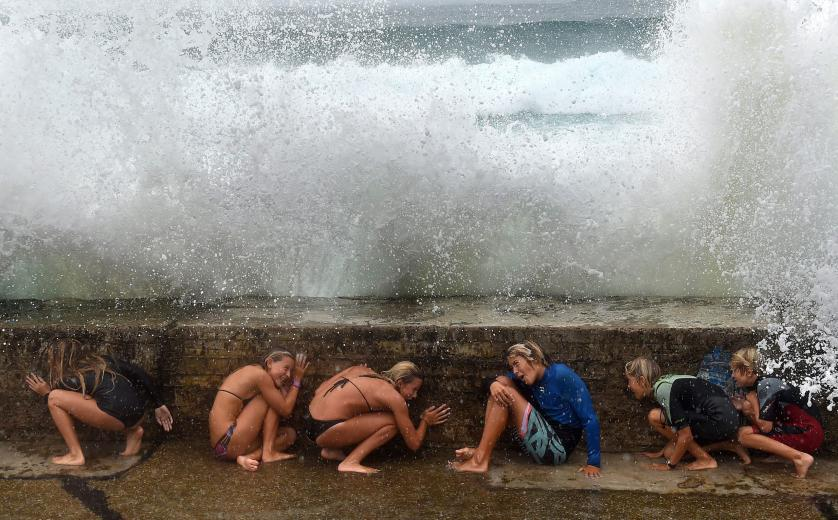 epa04986336 YEARENDER 2015 FEBRUARY Young people take shelter from big sea waves due to the Tropical Cyclone Marcia on the Gold Coast, Queensland, Australia, 20 February 2015. EPA/DAVE HUNT AUSTRALIA AND NEW ZEALAND OUT