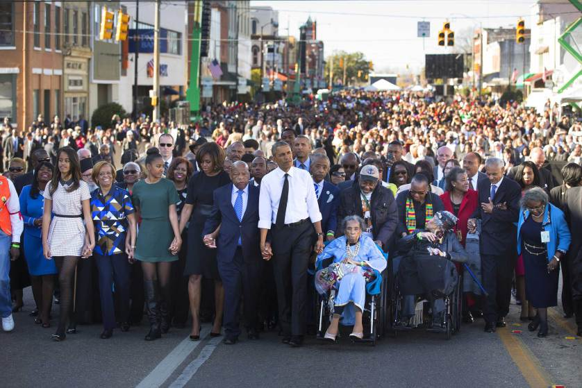 President Barack Obama, Amelia Boynton, right, Rep. John Lewis (D-Ga.) and the first family lead a march toward the Edmund Pettus bridge, 50 years to the day after ìBloody Sundayî in Selma, Ala., March 7, 2015. In an address, Obama rejected the notion that race relations have not improved in the years since -- as well as the notion that racism has been defeated. (Doug Mills/The New York Times)
