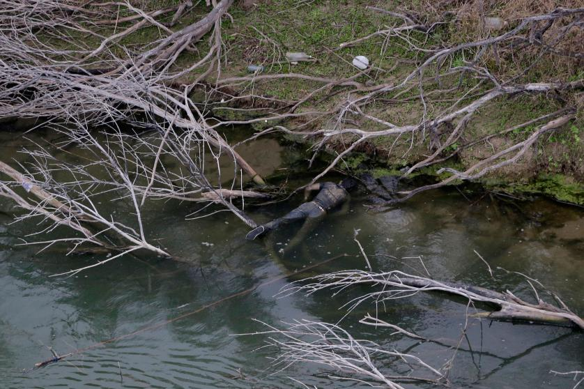 EDS NOTE: GRAPHIC CONTENT - A body discovered by the U.S. Customs and Border Protection Air and Marine while on patrol near the Texas-Mexico border floats in the Rio Grande, Tuesday, Feb. 24, 2015, in Rio Grande City, Texas. Five bodies were found at the scene. (AP Photo/Eric Gay)