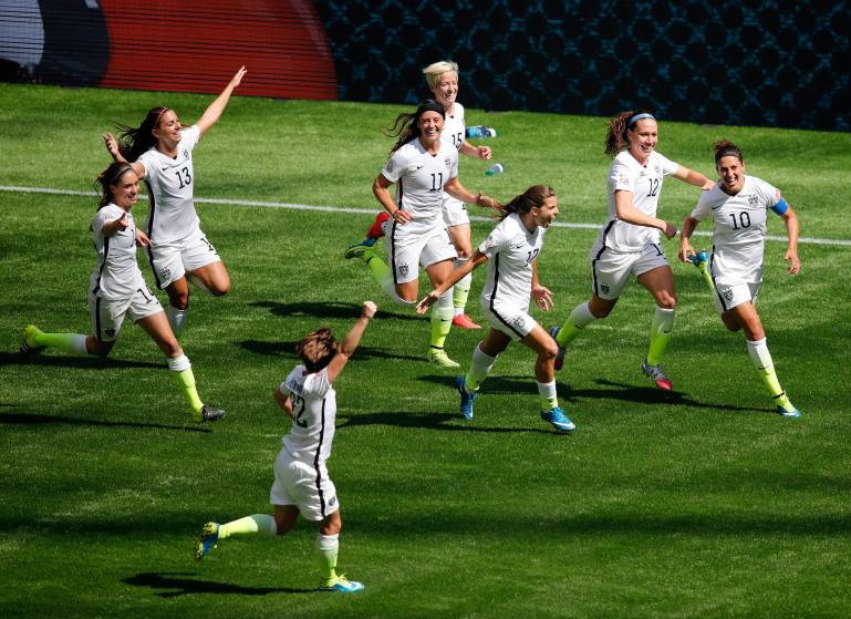 Jul 5, 2015; Vancouver, British Columbia, CAN; United States midfielder Carli Lloyd (10) celebrates with teammates after scoring against Japan during the first half of the final of the FIFA 2015 Women's World Cup at BC Place Stadium. Mandatory Credit: Erich Schlegel-USA TODAY Sports