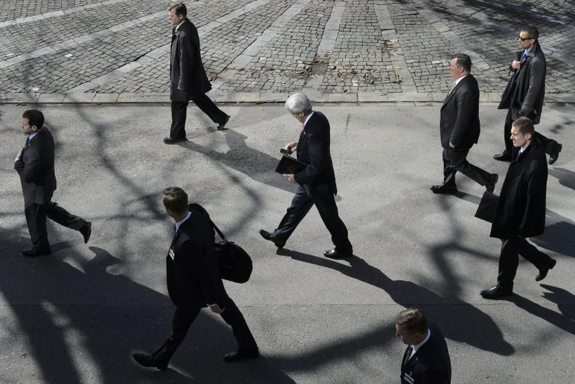 epa04986417 YEARENDER 2015 MARCH US Secretary of State John Kerry, (C), walks as he takes a break for the lunch time after a bilateral meeting with Iranian Foreign Minister Mohammad Javad Zarif (not pictured) for a new round of Nuclear Iran Talks, in Montreux, Switzerland, 03 March 2015. EPA/JEAN-CHRISTOPHE BOTT