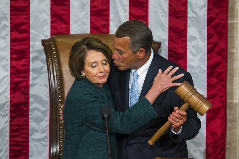 epa04986324 YEARENDER 2015 JANUARY Republican Speaker of the House from Ohio John Boehner (R) kisses Democratic House Minority Leader from California Nancy Pelosi (L) after Boehner was re-elected as Speaker of the House on the floor of the House of Representatives in the US Capitol in Washington, DC, USA, 06 January 2015. EPA/JIM LO SCALZO