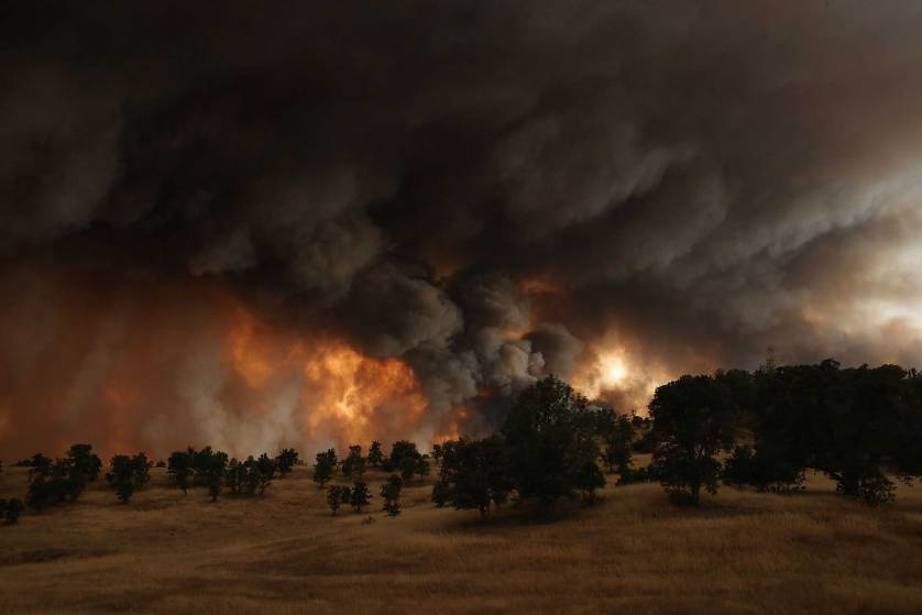 CLEARLAKE, CA - AUGUST 01: A large plume of smoke rises from the Rocky Fire on August 1, 2015 near Clearlake, California. Over 1,900 firefighters are battling the Rocky Fire that burned over 22,000 acres since it started on Wednesday afternoon. The fire is currently five percent contained and has destroyed at least 14 homes. (Photo by Justin Sullivan/Getty Images)