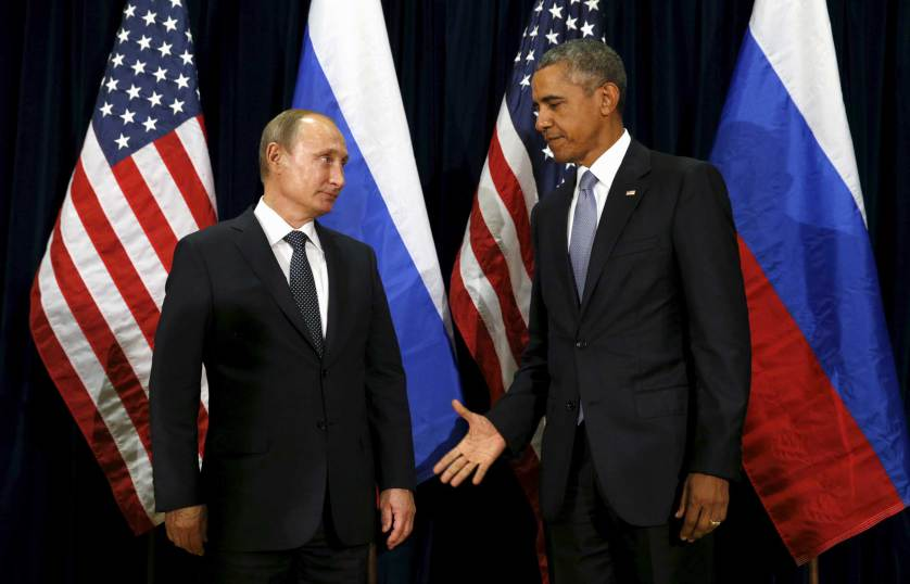 U.S. President Barack Obama extends his hand to Russian President Vladimir Putin during their meeting at the United Nations General Assembly in New York September 28, 2015. REUTERS/Kevin Lamarque - RTX1SYBB