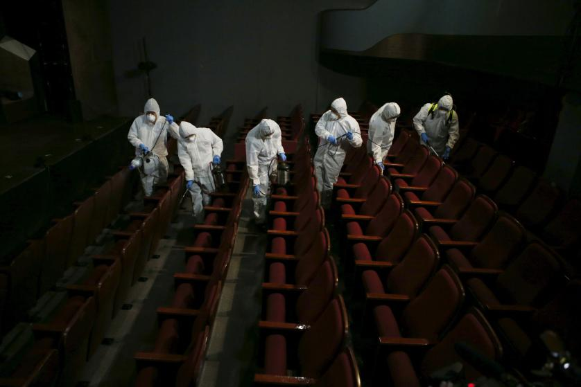 Employees from a disinfection service company sanitize the interior of a theater in Seoul, South Korea, June 18, 2015. An outbreak of Middle East Respiratory Syndrome (MERS) threatens to deal a blow to South Korea's economic recovery, Moody's Investors Service said on Thursday, as the Health Ministry reported three new cases, the lowest daily increase in 17 days. REUTERS/Kim Hong-Ji