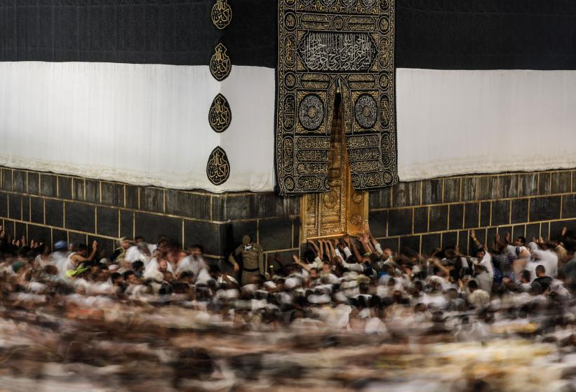 In this Monday, Sept. 21, 2015 photo taken with a slow shutter speed, Muslim pilgrims circle the Kaaba, the cubic building at the Grand Mosque in the Muslim holy city of Mecca, while performing Tawaf, an anti-clockwise movement around the Kaaba and one of the main rites of the annual pilgrimage, known as Hajj, in Saudi Arabia. (AP Photo/Mosa'ab Elshamy)