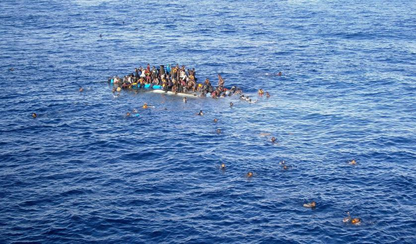 epaselect epa04712791 A†handout picture made available by German shipping company Opielok Offshore Carriers (OOC) on 20 April 2015 shows a boat with refugees close to the cargo ship 'OOC†Jaguar' in the Mediterranean sea on 12 April 2015. The ships of the German shipping company Opielok Offshore Carriers have rescued more than 1,500 people in the Mediterranean sea since December 2014. EPA/Opielok Offshore Carriers Mandatory Credit: Opielok Offshore Carriers HANDOUT EDITORIAL USE ONLY