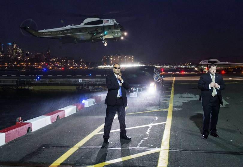TOPSHOTS US Secret Service Agents stand guard as Marine One, with US President Barack Obama board, prepares to land at the Downtown Manhattan Heliport in, New York City, on November 2, 2015. Obama is traveling to attend Democratic fundraisers. AFP PHOTO / SAUL LOEBSAUL LOEB/AFP/Getty Images