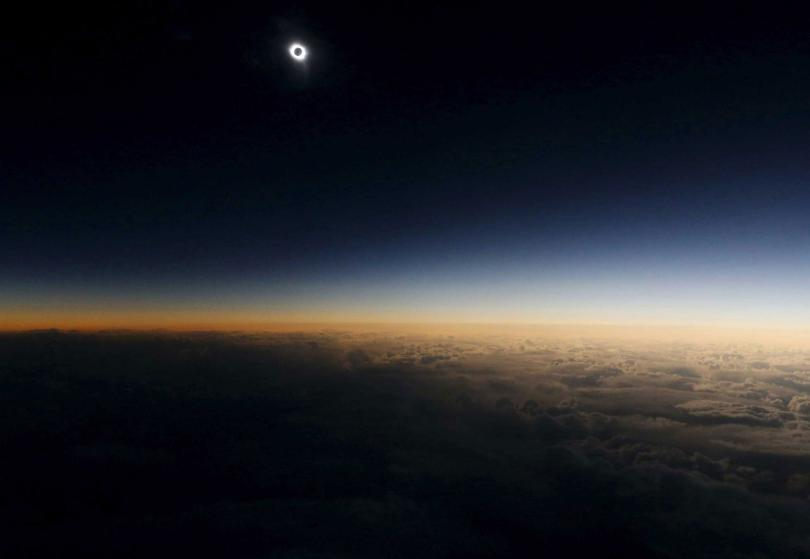 "A view from a plane during the so-called ""Eclipse Flight"" from the Russian city of Murmansk to observe the solar eclipse above the neutral waters of the Norwegian Sea, March 20, 2015. REUTERS/Sergei Karpukhin"