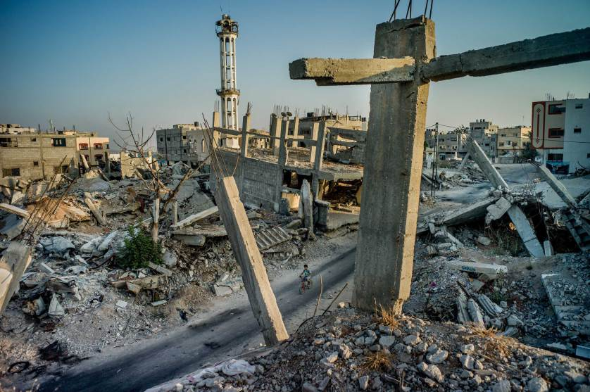 Shejaiya, the destroyed neighborhood abutting the border fence with Israel, in Gaza City, Gaza Strip, Aug. 1, 2015. A year after hostilities ended between Israel and Palestinian militants, not a single one of the nearly 18,000 homes destroyed or severely damaged in the fighting has been rebuilt, despite some $2.5 billion pledged for reconstruction. (Tomas Munita/The New York Times)