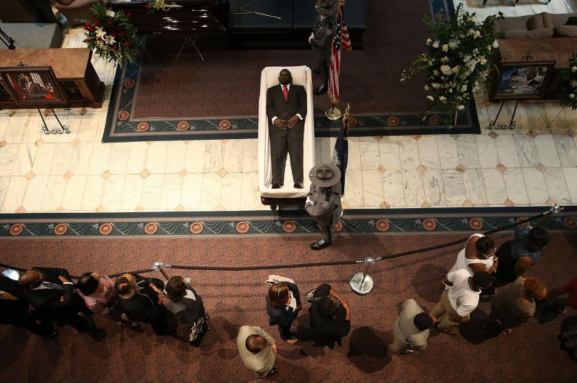 COLUMBIA, SC - JUNE 24: Visitors pay their respects during an open viewing for Rev. Clementa Pinckney at the South Carolina State House June 24, 2015 in Columbia, South Carolina. Pinckney was one of nine people killed during a Bible study inside Emanuel AME church in Charleston. U.S. President Barack Obama and Vice President Joe Biden are expected to attend the funeral which is set for Friday June 26 at the TD Arena. (Photo by Win McNamee/Getty Images) *** BESTPIX ***